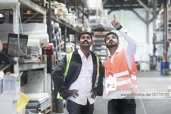 Engineers working in warehouse