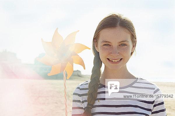 Girl with pinwheel on seaside holiday