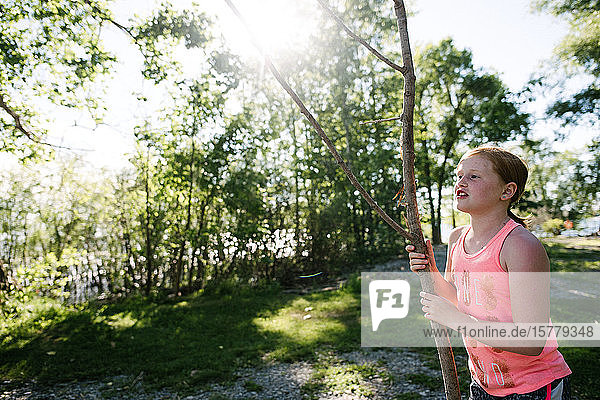 Girl exploring with stick  Kingston  Canada