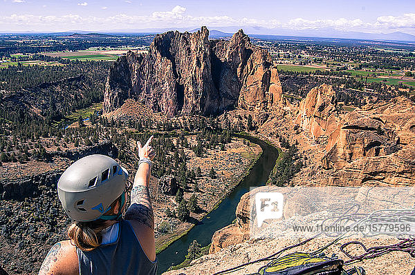 Rock climber pointing at rock formation  Smith Rock State Park  Terrebonne  Oregon  United States