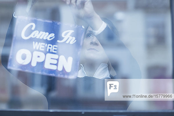 Close up of 'Open' sign in a shop window.