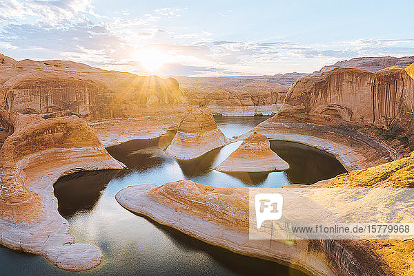 Ovewrhead view of Reflection Canyon  river bends and canyon gorge near Lake Powell at sunrise.