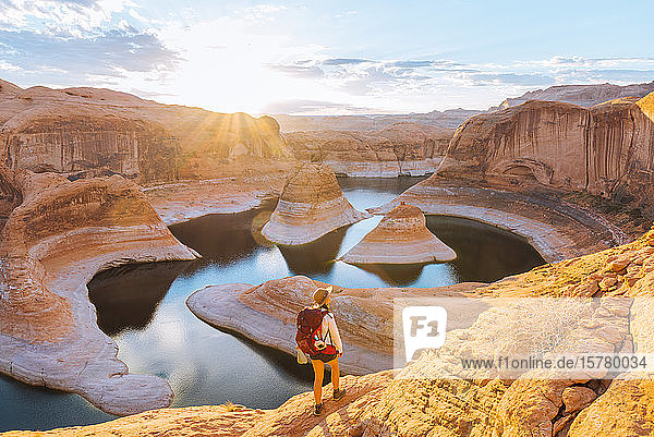 Backpacker at sunrise  Reflection Canyon  Lake Powell  Utah  US