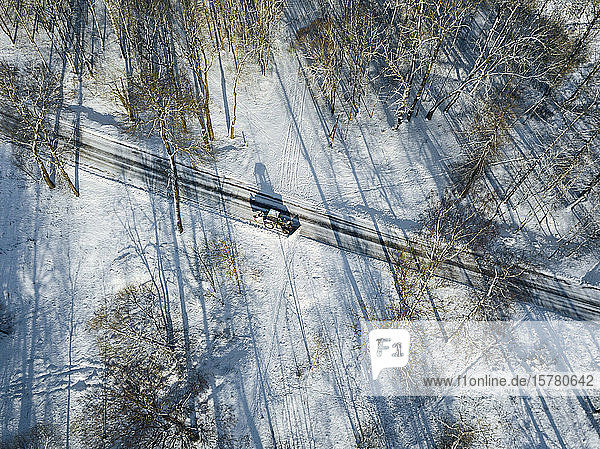 Russia  Saint Petersburg  Aerial view of snowplow clearing snow off country road