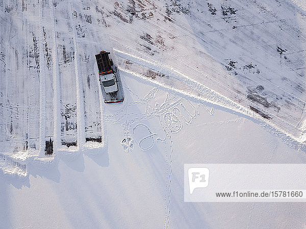 Russia  Leningrad Oblast  Tikhvin  Aerial view of snowplow clearing parking lot
