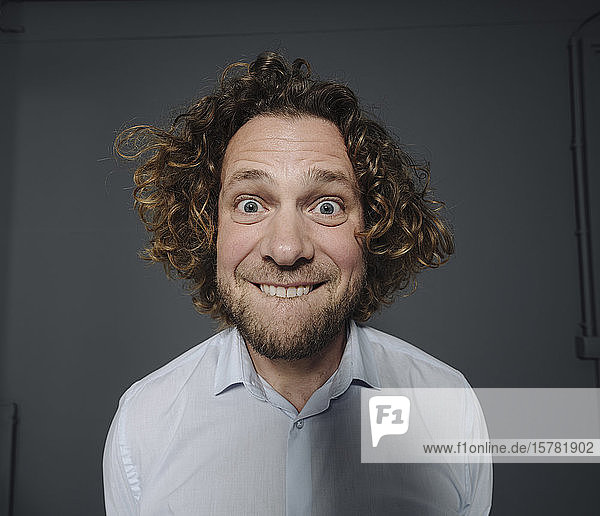 Portait of businessman pulling funny faces