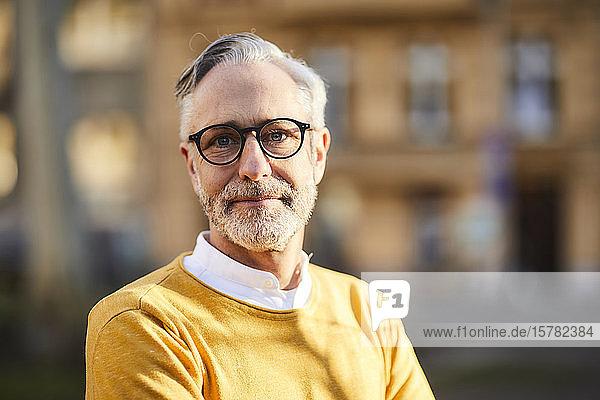 Portrait of confident mature man outdoors