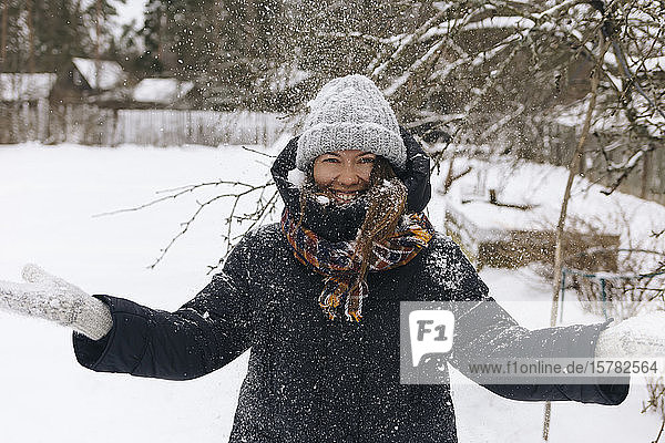 Portrait of woman enjoying snowfall