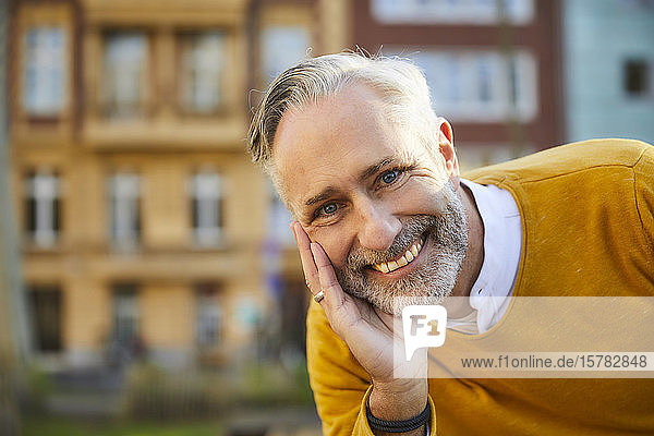Portrait of smiling mature man in the city
