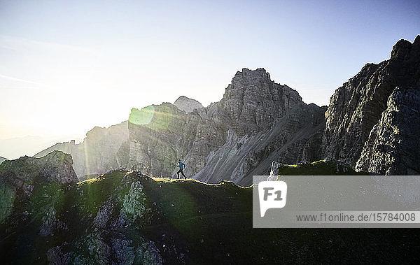 Man running on mounitain ridge at Axamer Lizum  Austria