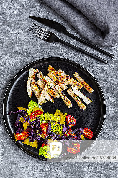 Turkey meat strips with vegetable salad