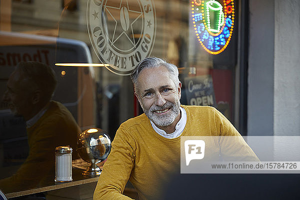 Portrait of smiling mature man in a cafe