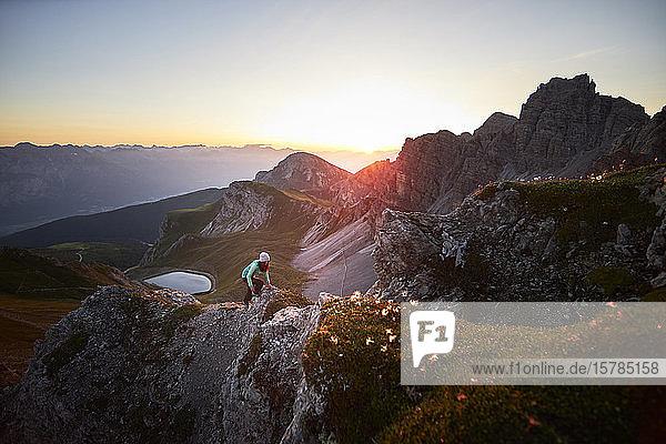 Woman climbing mountain ridge at Axamer Lizum  Austria