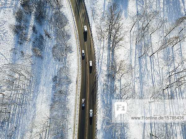 Russia  Saint Petersburg  Aerial view of cars driving along country road in winter