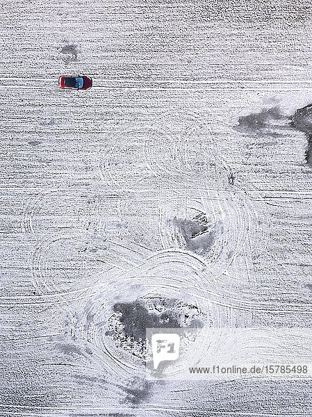 Russia  Moscow Oblast  Aerial view of car driving in snow-covered field