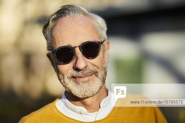 Portrait of mature man wearing sunglasses outdoors