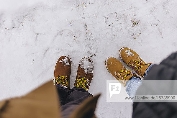 Couple wearing leather boots in winter