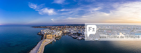 Italy  Apulia  Monopoli  Aerial view of sea and old town at sunset