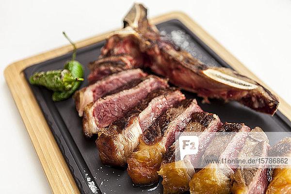 T-bone steak on fancy dish