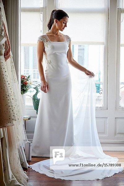 Bride trying on wedding dress in atelier of clothing designer  Bilbao  Spain
