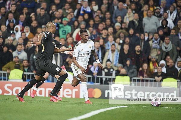 Vinicius Junior (forward  Real Madrid)  Kyle Walker (defender  Manchester City FC)  Fernandinho (midfielder  Manchester City FC) in action during the UEFA Champions League round of 16 first leg match between Real Madrid and Manchester City F.C. at Santiago Bernabeu on February 26  2020 in Madrid  Spain