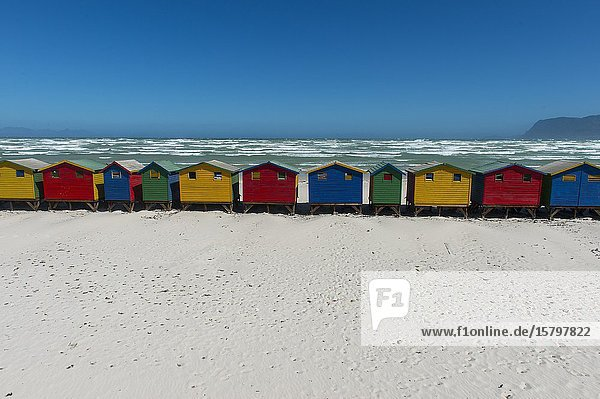 View of colorful beach changing huts on the beach at Muizenberg  a beach-side suburb of Cape Town  South Africa.