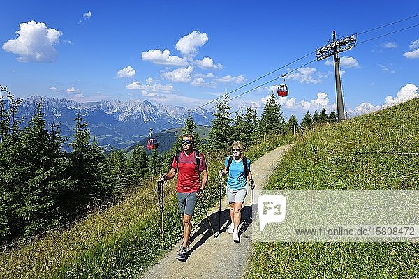 Hikers on the summit panorama trail of the Hohe Salve  Hopfgarten  Brixental  Kitzbühel Alps  Tyrol  Austria  Europe