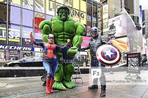 Marvel figures Hulk  Spiderman and Captain America can be photographed with tourists  Times Square  Manhattan  New York City  New York State  USA  North America
