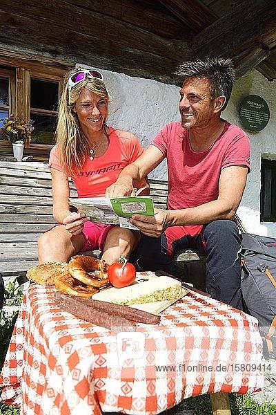 Hikers having a snack at the Schreckalm  Geigelstein  Sachrang  Chiemgau  Upper Bavaria  Bavaria  Germany  Europe