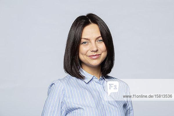 Portrait confident brunette businesswoman