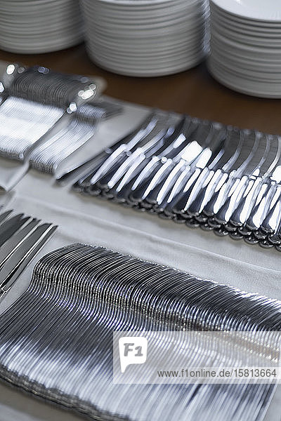 Caterers silverware organized in rows