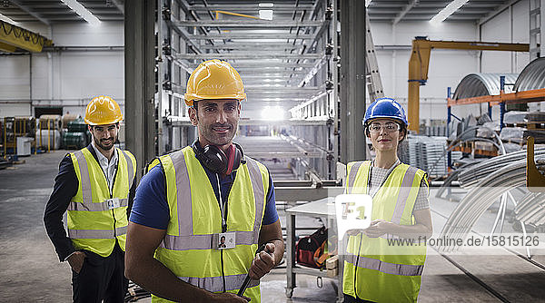Portrait confident supervisors and worker in steel factory