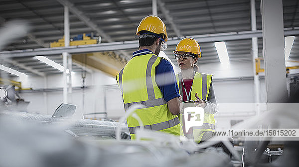 Workers with digital tablet working in factory Workers with digital tablet working in factory