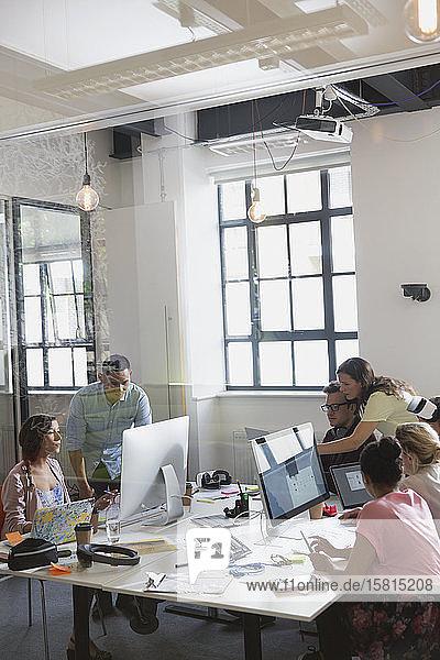 Designers working in open plan office Designers working in open plan office