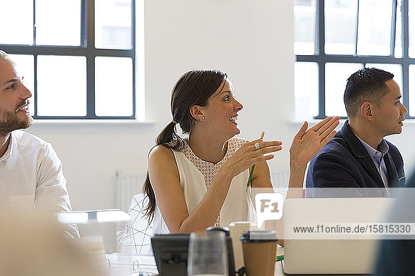 Businesswoman talking  gesturing in conference room meeting Businesswoman talking, gesturing in conference room meeting