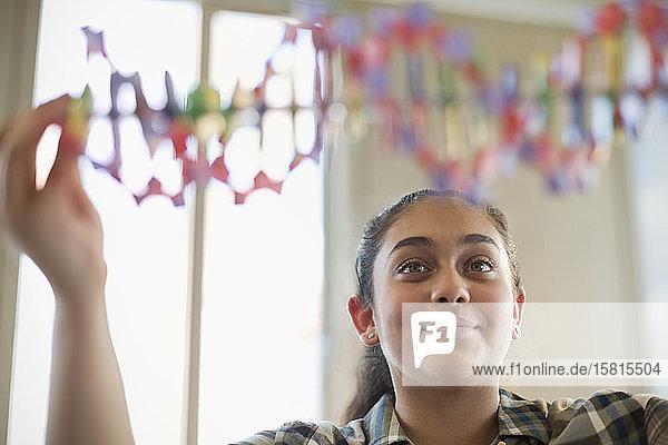Girl student examining DNA model in classroom Girl student examining DNA model in classroom