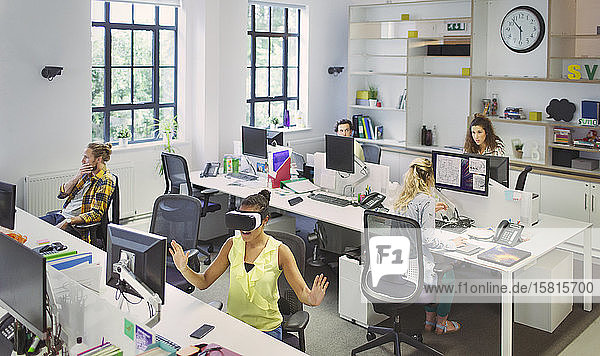 Designers working at desks in open plan office