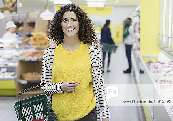 Portrait smiling  confident woman shopping in supermarket