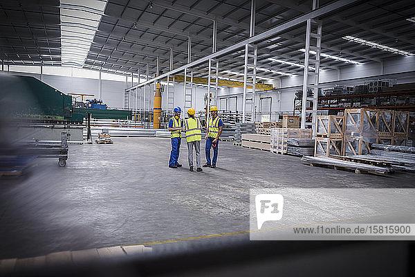 Workers talking in factory Workers talking in factory