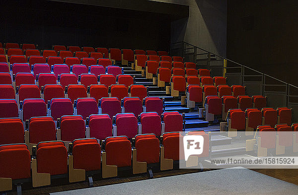 Red seats in empty auditorium Red seats in empty auditorium