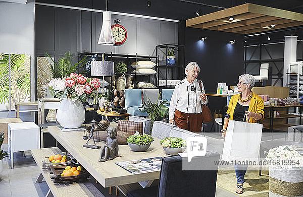 Senior women shopping in home decor shop Senior women shopping in home decor shop