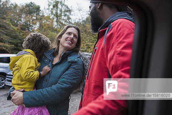 Multiethnic family talking in parking lot Multiethnic family talking in parking lot