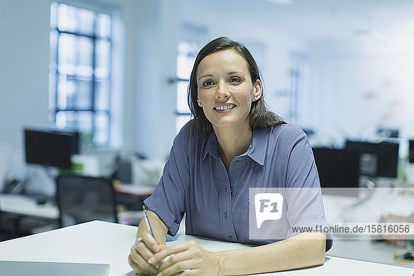 Portrait smiling  confident businesswoman in office