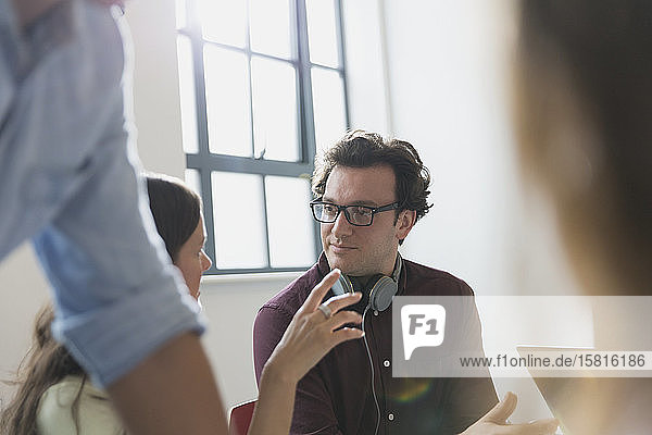 Businessman talking  gesturing in conference room meeting Businessman talking, gesturing in conference room meeting