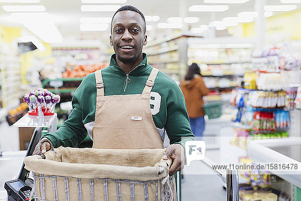 Portrait confident male grocer working in supermarket Portrait confident male grocer working in supermarket