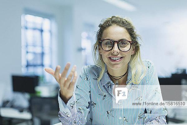 Portrait smiling  confident  gesturing businesswoman in office Portrait smiling, confident, gesturing businesswoman in office