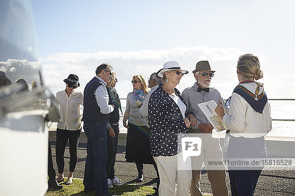 Tour guide talking with active senior tourists