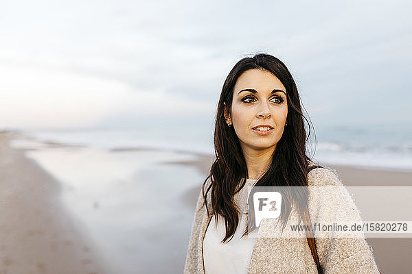 Portrait of a young woman on a remote beach at sunset