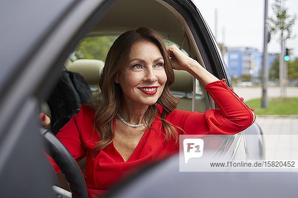 Portrait of smiling mature woman in car