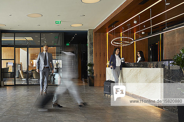 Businesswoman at reception desk in hotel
